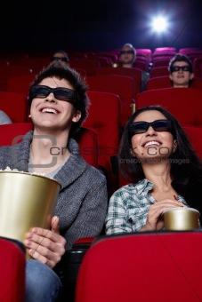 Smiling couple at cinema