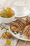 chocolate croissants, grapes and coffee