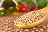Raw Lentils on Wooden Spoon