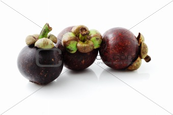 Three fresh mangosteens