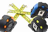 Measuring tapes criss crossing each other