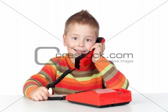 Adorable child with a tradicional telephone