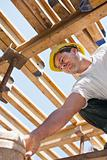 Construction worker under formwork girders