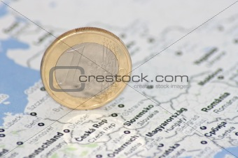 one euro coin on the map of Europe