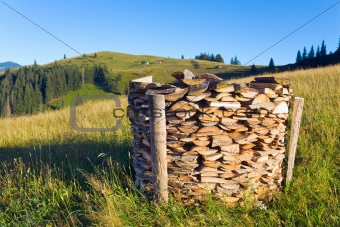 firewood stack on summer mountains