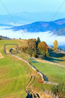 Autumn misty morning mountain hill