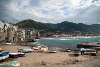 Beach in Cefalu, popular touristic village at the island of Sici