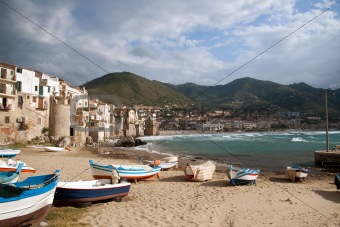 beach and waterfront of cefalu in sicily,italy