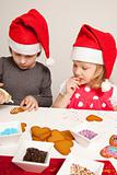 Girls decorating gingerbread cookies
