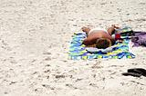 Lone sunbather Laying on Sandy Beach
