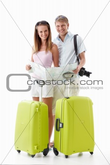 Attractive couple with suitcases