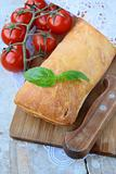 traditional Italian ciabatta bread with tomato and basil