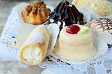 several kinds of cakes on a special stand dessert plates
