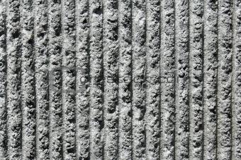 Gray cement wall with vertical lines