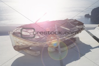 Old boat on the roof in Santorini with sea view
