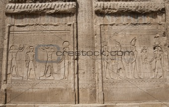Hieroglyphic carvings on an Egyptian temple wall