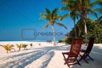 beach chairs on a perfect tropical island
