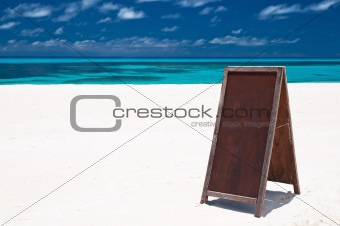 blank menu board at the beach