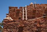 Southwestern Hopi House 1905 Architecture Abstract with Wooden Ladders and Clear Blue Sky.