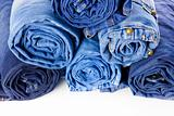 Rolls of Blue Jeans isolated on white background