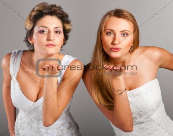 beautiful brides is blowing kisses