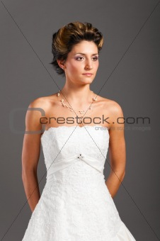 beautiful bride on grey background