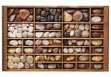 river pebbles in typesetter drawer