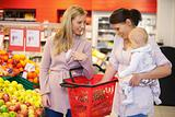 Mother carrying child with friend while shopping