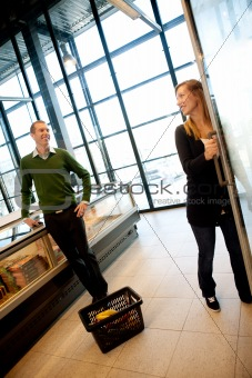 Flirting Couple in Supermarket