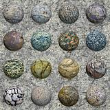 Set of stone balls on granite wall - seamless texture