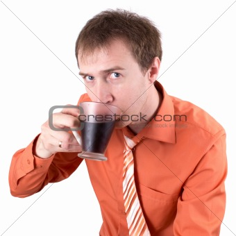 The young man drinks coffee
