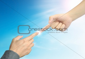 woman hand touch businessman hand on blue sky background