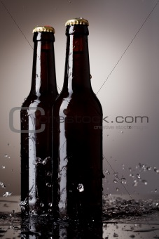 Beer bottles with water splash