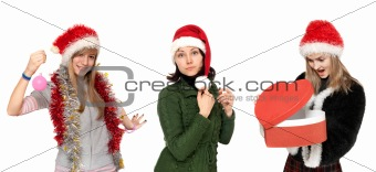 Three girls in Christmas hat with gift