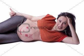 A pregnant woman lies