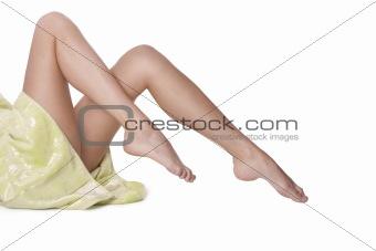 Beautiful naked female legs at white background.