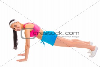 Smiling young sportsgirl doing push-up