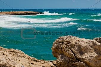 Waves in the sea near rocky coast