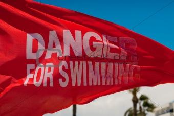 """Waving flag """"Danger for swimming"""""""