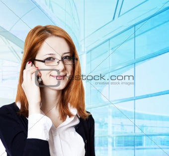 Business women calling by phone.