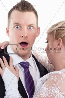 Surprised groom with wife