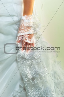 Woans hand in wedding dress