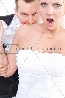 Groom bite's shoulder of the bride