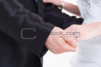 Bride and groom holding hand