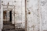 Abandoned building interior with white walls