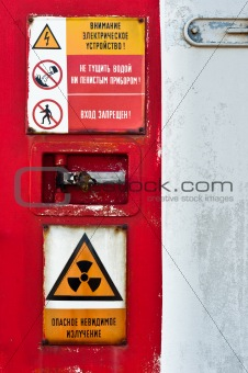 Closed door of a nuclear facility with signs