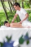 Beautiful woman getting massage from a therapist