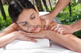 Attractive Caucasian woman getting massaged