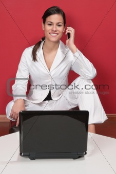 Smart young executive using cell phone