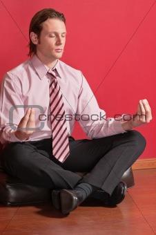 Smart businessman sitting in yoga lotus position